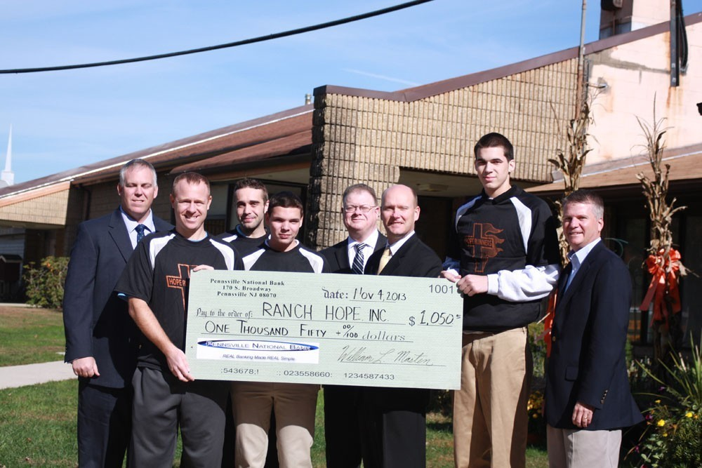 Group holding large check