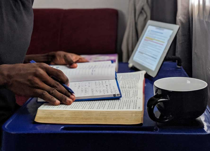 Male hands with bible and notebook
